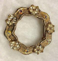 Vintage aurora borealis rhinestones floral design circle pin. 1950's