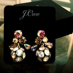 """J Crew iridescent crystal earrings NWT J Crew iridescent dangle earrings. Unique and full of sparkly color. ✨ Pink, light peach, and clear crystals. One ball drops from the post of crystals. Total length of earring approx 1 1/4"""". Pierced post. J. Crew Jewelry Earrings"""