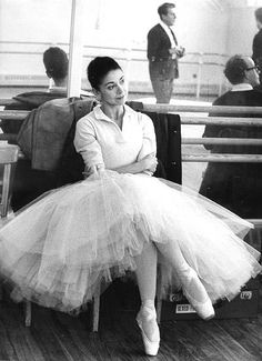 Margot Fonteyn: Prima Ballerina relaxing during rehearsal (Frederick Ashton can be seen in the mirror)