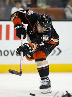 Andrew Cogliano of the Anaheim Ducks shoots the puck during the third period of a game against the Calgary Flames Ice Hockey Teams, Hockey Players, Western Conference, Anaheim Ducks, Calgary, Nhl, Period, Third, Superhero