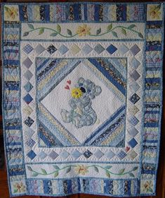 Baby Quilt Designs for Boys   Patchwork and applique design in blue for a little boy no pattern