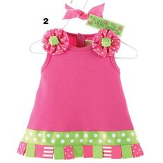 646885e6525 Dress your little girl up in style with this attention-grabbing hot pink  sundress. This hot pink cotton interlock dress is accented by grosgrain  ribbon tabs ...