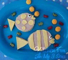 Crackers, lunch meat, and cheese for the bigger fish. the cheese balls for the bubbles and gold fish for little fish! :) so cute