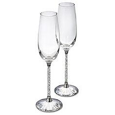 Crystalline Toasting Flutes (set of 2)  Delicate, elegant, and very festive, this is a set of two flutes for very special occasions. The clear crystal that fills the stems and the faceted clear crystal base of each of these adds an element of romance to any evening - making it a touch more special.