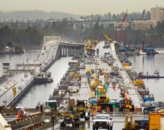 The new Highway 520 floating bridge, seen looking west from the Evergreen Point Lid in Medina, will open in April, with several public events planned before traffic gets moving. (Mike Siegel/The Seattle Times)