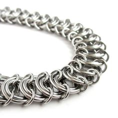 A wide vertebrae weave chainmaille anklet for men or women, created from durable stainless steel jump rings. The anklet was hand woven using 3 jump ring sizes in two wire gauges. Medium sized jump rings are perfectly encircled by large rings and the chain is completed with small jump rings. The finished piece was tumble polished for hours to ensure a beautiful shine. A large stainless steel lobster claw adds a secure closure. This is a very flexible and comfortable piece of jewelry. - Anklet…