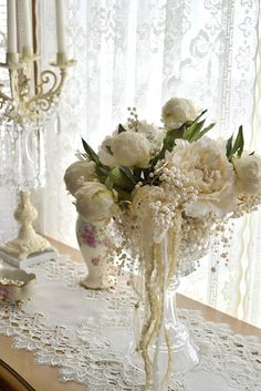 Beautiful flowers, pearls and lace  Photo by Jennelise