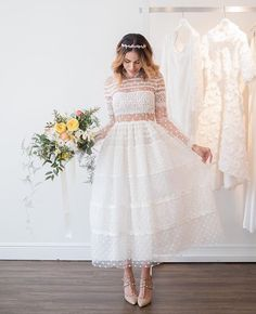 So in love with this dainty, feminine, tea length wedding dress from designer @christoscostarellos