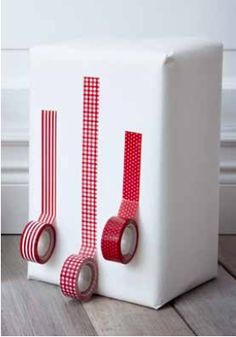 Christmas Holiday Gift Wrap - Use decorative tape instead of ribbon.