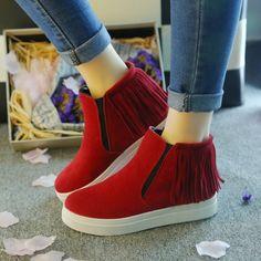 Womens Trendy Modern Tassle Slip-On Sneaker Boots