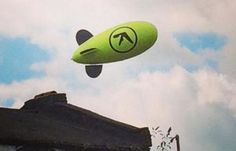 A Blimp With Aphex Twin's Logo Is Flying Over London - http://blog.lessthan3.com/2014/08/aphex-twin-blimp-london/