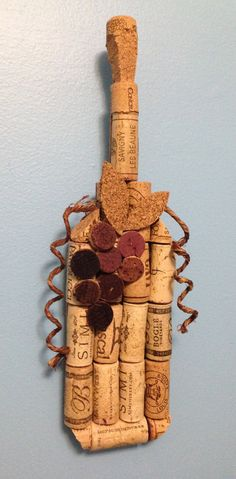 Do you or a family-member or friend have a wine-themed kitchen or bar that needs that extra something? This cork wine bottle wall hanging is for you!  Each bottle measures approximately 12.5 inches tall by 3.5 inches wide (decorative leaves extend to about 5 inches wide), with a depth of approximately 1 inch. They are 100% handmade via an intricate process of cutting, drilling, wiring, pinning, and gluing a variety of recycled wine corks. Bottles are backed with a layer of cork and wired…