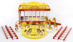 "Lot 630: Fisher-Price Circus Wagon and Ventriloquist Dummy Assortment; Three items including the 1962 #900 circus wagon with ladders and animals, a 1968 Juro Novelty ""Charlie McCarthy"" style ventriloquist doll and a Juro Novelty ""Talking Clown"""