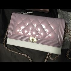 Chanel Wallet Chain Iridescent Patent Leather Boy Brand: Chanel Style: WOC  Type: Wallet on Chain  Color: Light iridescent lavender  Material: Patent leather  Condition: New with tag, original packaging & receipt. Lower prices on VeblenX.com CHANEL Bags Crossbody Bags