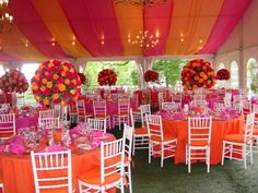 Don't really like how over-done this is & w/the tent that color, but I would like parts of it- just not all together at once.  Hot pink and orange tent wedding hot-pink-and-orange-weddings