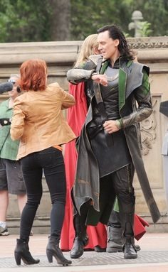 Tom and Scarlet duke it out with friendly punches between takes.