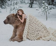 Olga Barantseva is a talented fairytale photographer based in Moscow, Russia, who captures her models with wild animals like: raccoons, white peacock, crocodile, fox, snake, horse, owl and more.