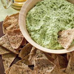 Creamy Spinach Dip | Try this light spinach dip made healthier with reduced-fat cream cheese, nonfat yogurt and low-fat cottage cheese instead of full-fat cheese, mayonnaise and sour cream. It will save you a whopping 84 calories and 10 grams of fat per serving when compared to traditional versions. Serve it with pita chips and crunchy vegetables or spread it on a sandwich.