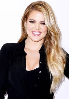 Khloé Kardashian's fluttery lashes, glowing skin, and mauve lip color are so beautiful