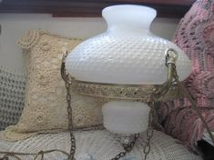 *~* This is a Beautiful Milk Glass Light That would hang from the ceiling.. It does work .The shade did get broke at the top of it in area along the top part.It has been glued and may not real noticeable being at the top of the light. Picture number 5 ....The bottom part is a piece of milk glass and does not light up.. Its not a light. .It measures 50 Inches long from to o the ceiling part to bottom of lamp. The chain fro ceiling to group of chains that go around the lamp shade. The group…