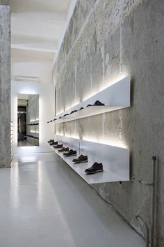 Retail Lighting La Scarpa, Sofia, simple white shelves and lights to display shoes. Design Shop, Showroom Design, Shop Interior Design, Design Commercial, Commercial Interiors, Retail Store Design, Retail Shop, Shoe Store Design, Store Interiors
