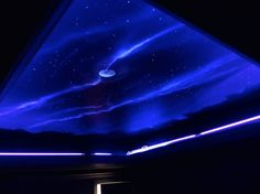 This stunning media room mural was painted on a ceiling by Bryan King of Artifice Inc. using our Wildfire Luminescent Paints and our Invisible Fluorescent Paint. This image shows the night sky created when only the blacklight is on for an amazing effect!