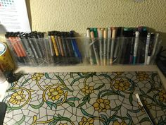 DIY marker and pen holder with 4 CD cases, a shower curtain and a lot of tape!