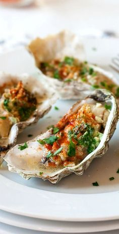 Grilled oysters (baked oysters) – oyster on the half shell with garlic, butter, parsley and paprika. Juicy, briny and crazy delicious | rasamalaysia.com