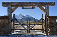 Should we do a classed up version of this? Liking it. Colorado ranch with wooden gate by Lightvision, via Dreamstime Farm Entrance, Driveway Entrance, House Entrance, Ranch Farm, Ranch Life, Front Gates, Entrance Gates, Ranch Fencing, Colorado Ranch