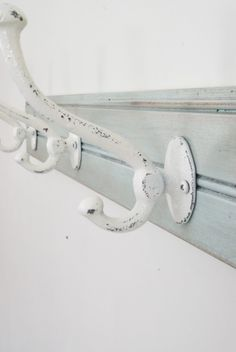 Like this idea...add hooks to a piece of moulding
