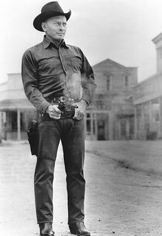 Russianborn American actor Yul Brynner shoots a pistol from the hip in a still from the science fiction film 'Westworld' directed by Michael Crichton. Western Movies, Tv Stars, American Actors, Movies, Yul Brynner, Science Fiction Film, Michael Crichton, Movie Stars, Westworld