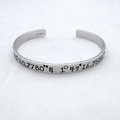 Custom Coordinate Bracelet can mean something so special to us; so wear yours on your wrist and smile each time you take a look and remember that special place.  With this listing you will receive one aluminium bracelet cuff hand stamped with your custom coordinates using the font Sweetheart