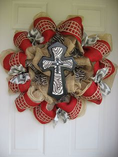 Very cute Tan deco mesh with Red burlap, Zebra burlap ribbon,Chrevon burlap, and a Zebra cross. on Etsy, $75.00