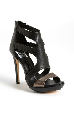 Black Heel with Metallic Strap.