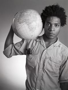 Jean-Michel Basquiat, photographed with the weight of the world on his shoulders by Christopher Makos on May 29, 1984
