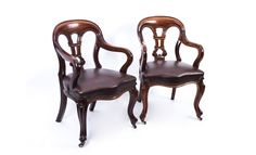 A lovely antique pair of William IV mahogany leather armchairs, circa 1830.
