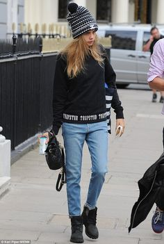 Cara Delevingne wearing Timberland 6-Inch Premium Waterproof Boot in Black Nubuck and Trapstar Irongate Base Sweater.