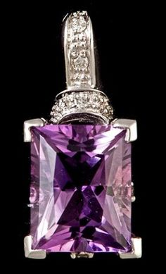 This 3.05 ct emerald cut purple amethyst gemstone pendant is set in 1.83 g of 14k white gold and accented on the bail with .06 ct of diamonds.