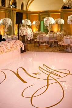 Custom monogrammed dance floor. Wedding Coordination By / thespecialday.net, Floral Design By / nisiesenchanted.com