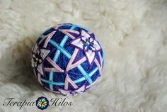 A hanging thread can be added to this item, at no extra cost. Send a convo and well arrange it for you!  This hand-made, embroidered ball based on an ancient Japanese craft, is made with recycled materials, including polyfiber stuffing, acrylic yarn and nylon and cotton threads. Symbolizing good luck and all the best wishes for you from the maker, it is the perfect decoration or gift for a loved one. Over a core of plastic and polyfiber stuffing, innumerable wraps of acrylic yarn and thread…
