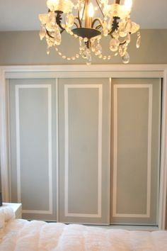 DIY:  Closet Door Facelift - if you have flat, boring doors in your home, this project is for you! These doors were taped, painted & then the tape was removed. Easy & inexpensive DIY makes a huge difference to a room!