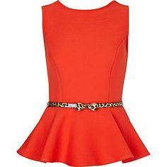 Work outfit idea. orange peplum leopard belt, black slacks