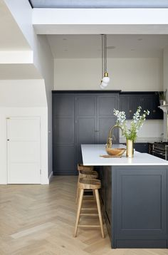 Beautiful large kitchen diner extension in London with bespoke oak herringbone floor, large steel windows and a bespoke kitchen by Naked. Interior design by Hannah Gooch Studio. Photo by Anna Stathaki. Budget Kitchen Remodel, Kitchen On A Budget, New Kitchen, Kitchen Decor, Kitchen Sinks, Kitchen With Window, Purple Kitchen, Awesome Kitchen, Rustic Kitchen