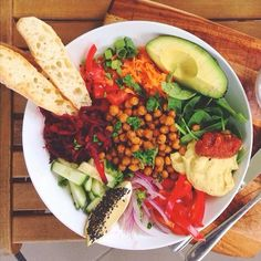 Mouth Watering Brunch Recipes - Rainbow Veggie Bowl: chickpeas,  turmeric, cumin, garam masala, salt, and cayenne pepper baked in the oven until golden and crisp. Serve with mixed vegetables including cucumbers, red onions, shaved beetroot, baby spinach, carrots, shallots, avocado, and bell peppers. Serve with a squeeze of lemon and fresh bread! | Recipe right this way...