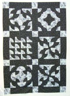 A sampler quilt of Drunkard's Path blocks