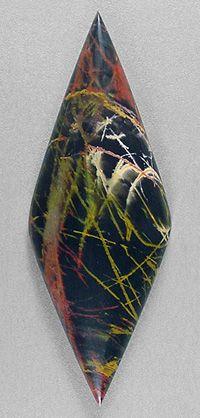 Pilbara jasper cabochon by lapidary artist Sam Silverhawk of Silverhawk's designer gemstones. © Silverhawk