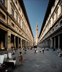 Uffizi gallery in Florence: Renaissance style...symmetrical arrangement of windows and doors, extensive use of classical columns and pilasters, triangular pediments, square lintels, niches with sculptures