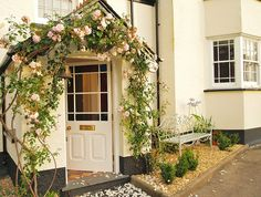 Exterior Doors | beautiful flowered archway for the front entrance | Bayer Built Woodworks