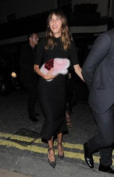 100 best dressed of 2014 - Alexa Chung in an all black midi dress + pink fur clutch and strappy pointy-toe kitten heels