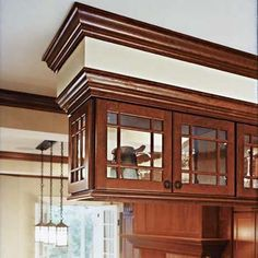 Ceiling hung cabinets, over a peninsula